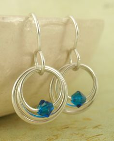My Three Hoops Petite Earrings - Argentium Sterling Silver and Your Pick of Swarovski Crystal. $20.00, via Etsy.