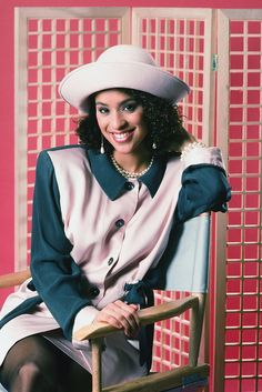 A classic Hilary ensemble: A nautical-style hat, drop pearl earrings (with a matching pearl necklace), and a strong-shouldered, teal and baby pink suit.  #refinery29 http://www.refinery29.com/2016/04/108048/hilary-banks-fresh-prince-90s-fashion-outfits#slide-1