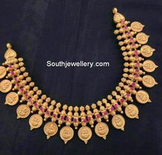 Antique finish 22 carat gold traditional Lakshmi kasulaperu necklace studded with rubies. Antique Jewellery Designs, Gold Earrings Designs, Gold Jewellery Design, Necklace Designs, Cz Jewellery, Gold Designs, Temple Jewellery, Designer Jewelry, Gold Wedding Jewelry