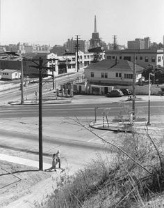 Looking southeast at the corner of 3rd Street and Beaudry Avenue in Los Angeles (1948). The Tanner Livery building on the east side of Beaudry is in the background, soon to be demolished to make way for the below-grade Harbor Freeway, over which 3rd Street became a bridge.