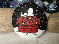 I wanted to do a Snoopy Christmas rock, but couldn't find the right original to work from. This is a composite of three different Snoopy-on-doghouse illustrations I found. Thanks for creating this phenomenal group of characters, Charles Schulz!