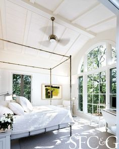All-white bedroom in pool cottage