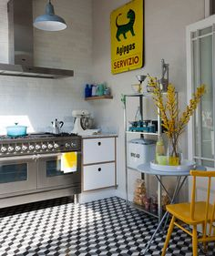Short on square inches? A tiny kitchen (and a tight budget) requires careful and creative planning. A gray-and-white palette gets a burst of charm from bright pops of lemon and turquoise. If you don't have much cabinet space, bring in freestanding pieces to hold appliances, dishes, and other kitchen essentials.