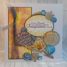 8x8 card made using Sheena – A Little Bit Scenic – Seashells stamp. Coloured with Spectrum Noir Sparkle Pens– Fig, Biscuit, Teacup, Hearthside, Peony, Moonlight & Crystal Clear Overlay. Designed by Marie Jones #crafterscompanion #spectrumnoir