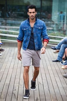 Plain Navy Blue Tshirt styled with Dark Blue Denim Jacket , Grey Shorts and a pair of Black sneakers