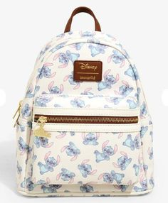 "Loungefly Disney Stitch Toss Backpack. Features and allover toss print of pastel Stitch with different poses. Burnished gold tone hardware and front pocket zipper pull with ""Ohana"" and a hibiscus flower. Adjustable straps and side pockets. Polyurethane 9""x5""x11"". So cute!"