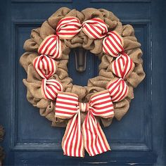 How to Make a Christmas Burlap Wreath. This season bring color and a festive holiday theme to your front door. Watch the video for this fun tutorial. #Christmas #burlap #wreath