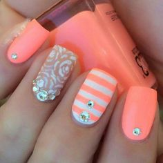 Orange white and flower nails