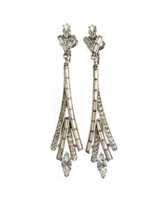 """Rhodium plated Art Deco inspired clip on earrings from Trifari's """"Lighting"""" Collection, from the late 1950′s. Marked: Trifari (c) Reference:Featured in the originaladverts for the """"Lighting"""" Collectionfrom 1961 onwards."""