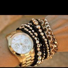 Bracelet stacking accompanies a Michael Kors watch so well...