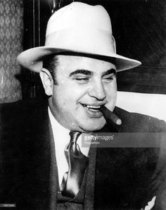 4th May 1932, Chicago, USA, American prohibition-time gangster Al Capone smiles as he smokes a cigar on his way to Atlanta Federal Penitentiary after conviction for Federal Income Tax Evasion