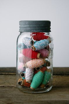 strings in jar; I have an unnatural obsession with color + white baker's twine NOW I KNOW WHAT TO DO WITH MY EMPTY PICKLE JAR!!! LOVE THIS!!!