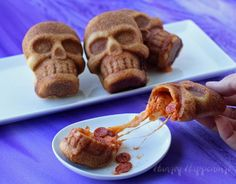 These Stuffed Pizza Skulls are spine tinglingly good! They look haunted and taste delicious! Find the recipe here.