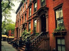 Brooklyn Brownstone - New York City. Artist:Vivienne Gucwa. The brownstones in Cobble Hill, Brooklyn feature some of the most classic architecture that people associate with New York City. In this photo, the red brick and beautiful door frames figure prominently looking down.