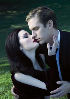 downton abbey, mary and matthew, but this pic makes them look like vampires.  which is awesome.