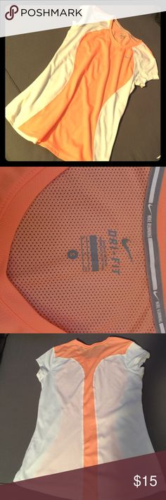 Nike Running Top NWOT Dri-fit material, mesh back. Orange and white nike running top. Never worn. Nike Tops Tees - Short Sleeve