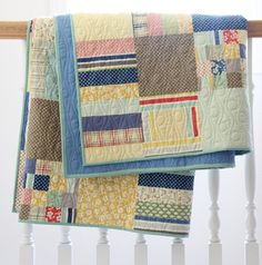 Folded Strips and Squares Quilt by Cluck Cluck Sew, She uses flat sheets as backing!
