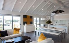 A large steel beam holds up the huge open living space below. Splashes of colour liven up the space. New Living Room, Living Area, Living Spaces, Metal Building Homes, Building A House, New Zealand Houses, Steel Beams, Open Space Living, Kit Homes
