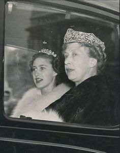 A close up of an older Princess Mary, in her scroll tiara, with he niece, Princess Margaret in 1950's