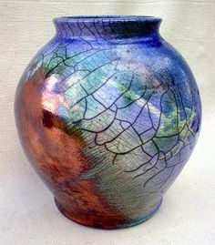 Lunar Eclipse raku pottery jar by ~anubistj on deviantART --  13 inches tall with a combination of 5 different glazes.  Raku fired pottery is a Japanese style of firing.  Made from white porcelain-like clay