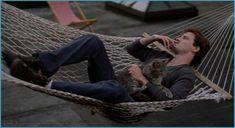 Aidan Quinn cat-lounging in Desperately Seeking Susan Aidan Quinn, Desperately Seeking Susan, Celebrities With Cats, Celebs, Sexy Tattooed Men, Steven Wright, Cat Hammock, Will Arnett, Nyc Restaurants
