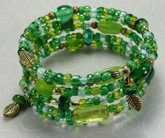 'Green and Gold Leaves Wrap Bracelet' is going up for auction at  9am Sun, Sep 2 with a starting bid of $10.