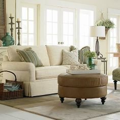 Build a room around a neutral sofa. I like all the accent pieces.