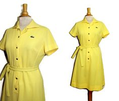 Adorable 60s yellow Lacoste dress. Short sleeves, buttons down the front with shiny gold buttons and of course the iconic alligator on the breast. Etsy $45