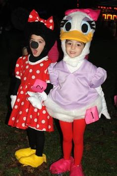 Minnie Mouse & Daisy Duck: My 3 year old twin girls wanted to dress as Minnie Mouse and Daisy Duck this year.  They asked their Nana to make them costumes, and after buying some