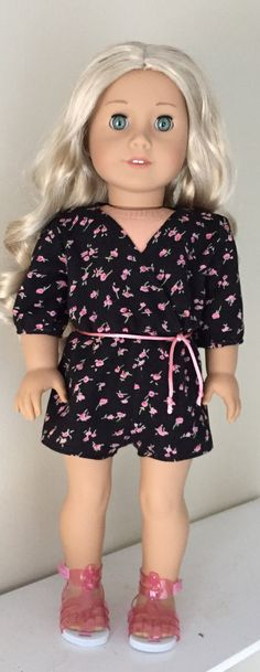 Black flowered romper by GumbieCatDollClothes on Etsy. Made with the Wrap Romper pattern. Get it here http://www.pixiefaire.com/products/wrap-romper-18-doll-clothes. #pixiefaire #wrapromper