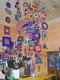 Shape mobile - patterns and shape each student create a string of patterned shapes to add to a group mobile hanging above their table group.Would be good for primary Tie in with Kandinsky?Shape Mobile, art for kids. Please also visit www. for colorful ins Kindergarten Art, Preschool Art, Arte Elemental, Classe D'art, Kandinsky Art, Kandinsky For Kids, Ecole Art, Shape Art, Elements Of Art