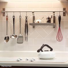 Backsplash racks offer easy access andstylish storage. Most versions take just afew minutes to install. Backsplash racks have a few disadvantages, though. All your kitchen utensilshave to look good, since they're on display.And if you ever decide to remove the rack,you'll be left with screw holes in the backsplash;not a big problem with drywall,but ugly and unfixable in tile.