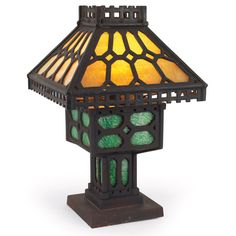Arts and Crafts table lamp, in iron, reticulated shade with geometric cut-out border