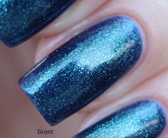 Grant - Deep navy to green duo chrome with intense green shimmer.  This polish glows! Swatch by @yyulia_m on Instagram.