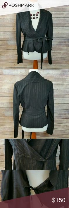 *LAST CHANCE!* BCBG Suit Jacket This black pinstripe blazer jacket from BCBG is absolutely gorgeous! It is a faux wrap blazer so it has a tie on the inside then a snap (both are shown in the 3rd immage) then there is are ties to cinch the waist. This jacket doesn't have a size, but it fit my mannequin rather well so I am estimating that this is a size S or 6. If you would like any measurements I would be more than happy to provide them. This jacket is in good condition. BCBGMaxAzria Jackets…