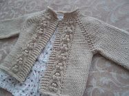 Knitted cardigan for an infant. I love raglan sleeve cardigans and this one is adorable.