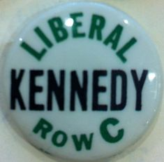 Everyone had their place at the 1960 Democratic Convention to nominate John F. Kennedy for president.  This button was worn by those JFK supporters and relegated them to Row C in the Convention Hall.   Green and black letters over a white background.
