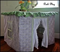 Card Table Playhouse- So me as a kid except I didn't have all that fancy lace just beach towels or blankets.