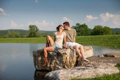 A couple kissing on the rocks by a lake. Copyright Photographics Solution 2013