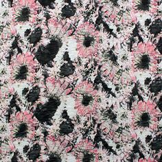 """Colors of pink, black, and yellow sunflower floral cotton jersey slub burnout knit. Black pieces of the print are burned out, so they are more sheer. Fabric has a nice stretch, light weight, and a good drape. Sunflowers measure 3"""" :: $6.00"""