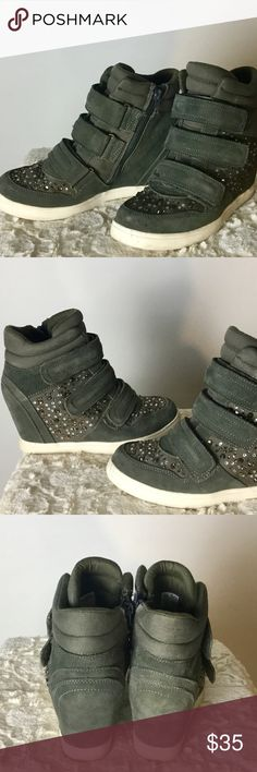 Aldo rhinestone army green velcro wedge sneakers Aldo rhinestone army green velcro wedge sneakers  Product Details: *Army Green Suede *3 Adjustable Velcro Closure *Side Zipper Opening *Rhinestone detail on toe and side of sneaker  Fit and Size: Size 9 Aldo Shoes Wedges