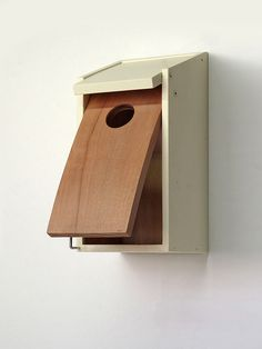 Wooden handmade birdhouse with a stylish curved by Woodpeckersshop, $60.00