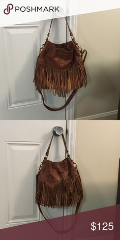 "Fossil Jules Large Fringe Drawstring Gently used Fossil Jules Large Fringe Drawstring bag. Purchased new from the Fossil store Summer 2016. Brown leather with brown cloth lining with a drawstring closure. 20"" strap drop length with the long strap. 11"" high 