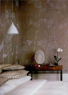 Chinoiserie walls, pillow shams, vintage desk