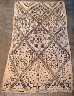 Ivory and un-dyed brown treads. Hand-woven Moroccan vintage pile rug.Collector piece, one of a kind Beni Ouarain rug from MoroccoUnique Geometrical designs in diamond shape lattice design in dark brown   Size:  6 ft 5 x 11 Ft 5 Circa 1960.