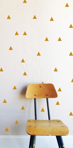 50 - 1.5w x 1.5h Triangles    Fully removable and reusable wall decals that will brighten and add character to any room. **PLEASE NOTE THAT