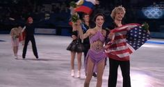 This basically sums up the nations as a whole. Russia: waiving their flag proudly above their heads for the fans, USA: Meryl and Charlie smiling cutely while holding the flag upside down, Canada: Scott wearing the poncho on his head while Tessa is doubled over laughing.