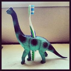 Dinosaur Toothbrush Holder Great idea for a little boys bathroom!Great idea for a little boys bathroom! Diy For Kids, Crafts For Kids, Baby Crafts, Plastic Animals, Plastic Animal Crafts, Boy Room, Child Room, Future Baby, Activities For Kids