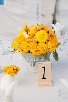 Yellow floral table number idea {Photo by Two One Photography}
