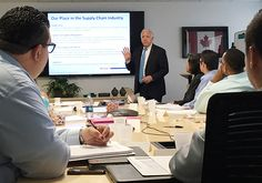 """Hats off to Purolator International's """"Class of 2016"""" Corporate Onboarding participants! New employees attended an April 19-20 workshop to learn about our business, our culture and our services. (In photo: Purolator International President John Costanzo talks about our role in the supply chain)"""